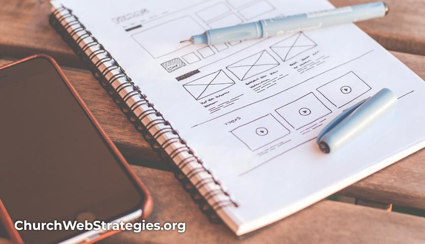 sketch book with website layout designs