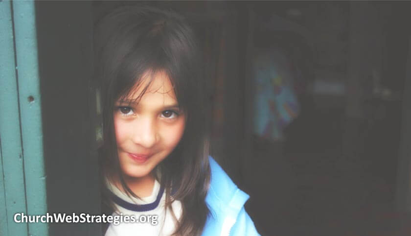 young orphan girl smiling