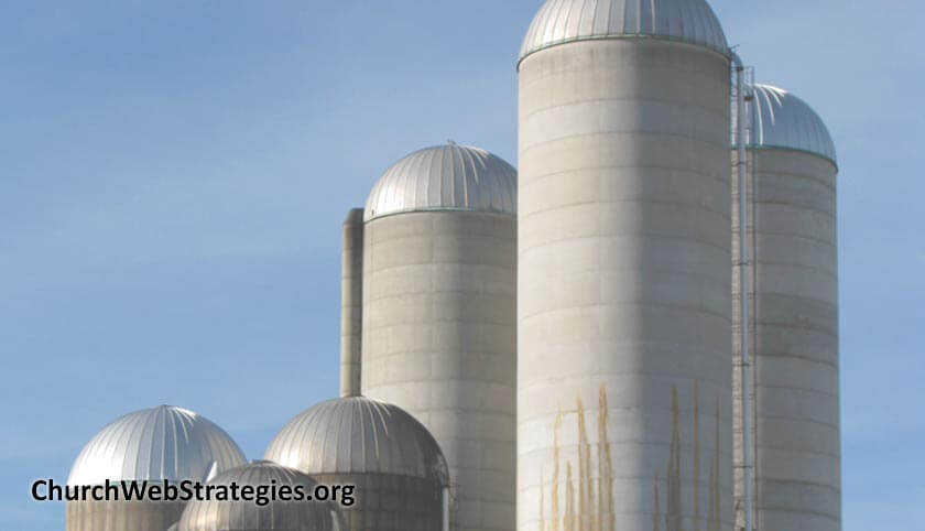 several grain silos on a farm