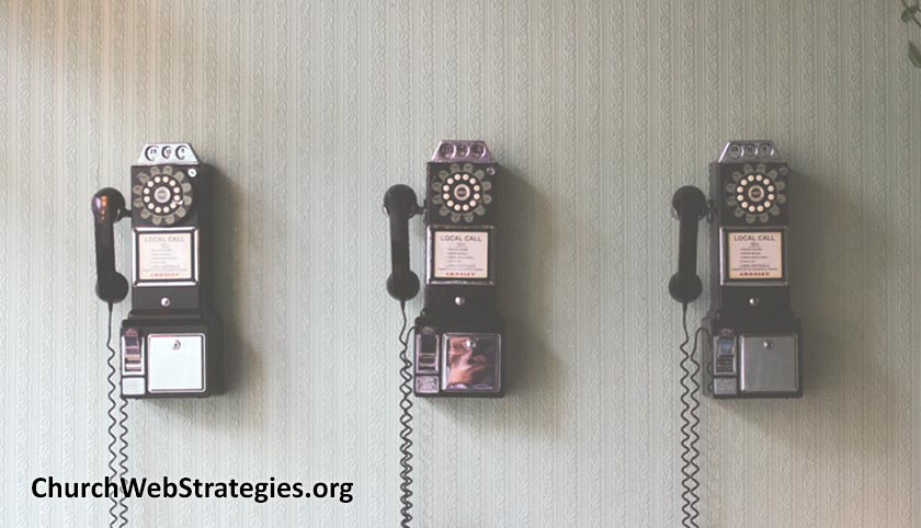 three payphones on a wall