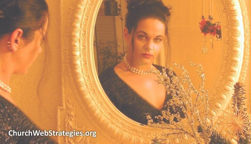woman in fancy attire staring at herself in a mirror